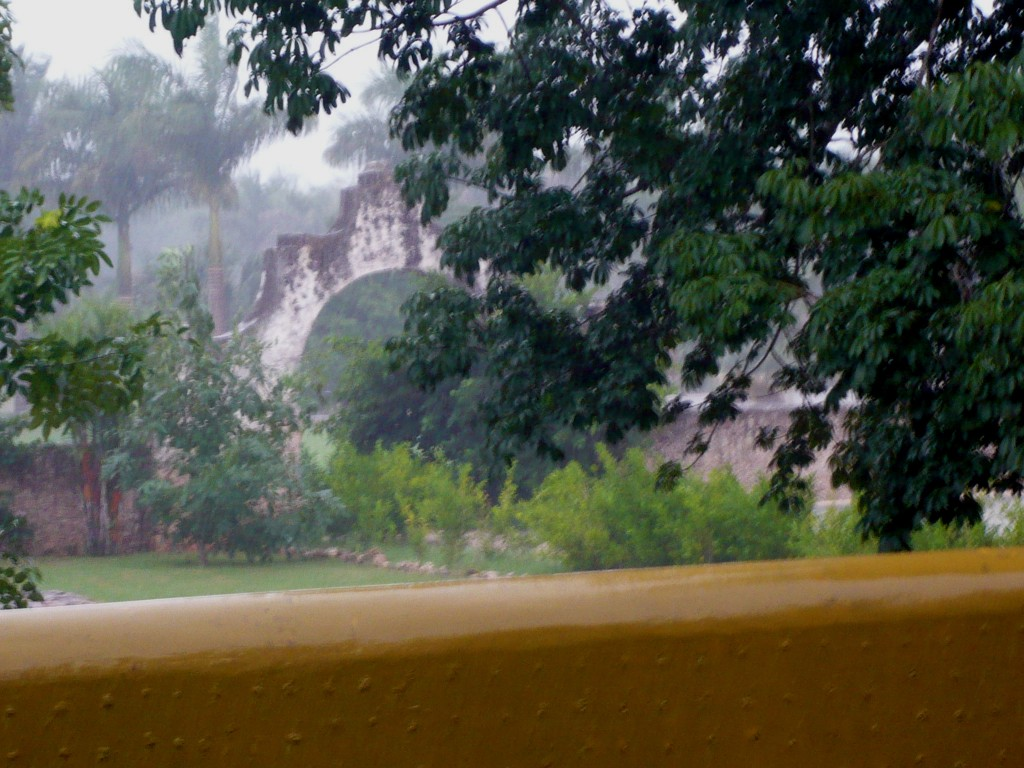 the ruins of the old hacienda seen through the rain