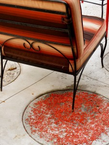 the round pavers are sprinkled with different shades of tumbled glass, here, the burnt orange stripe sings with the tangerine sprinkles