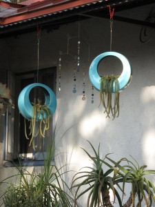 see the little lightchimes in between the super cool hanging containers?